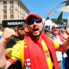 Liverpool fans react at the fan zone in Kiev