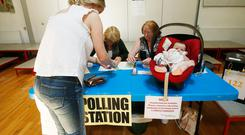 Nicola Faherty with Freya Molloy (4months) from Greystones casting a vote at Delgany National School,Co Wicklow this afternoon. Photo: Stephen Collins/Collins Photos