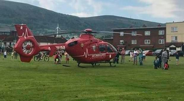 The Air Ambulance was scrambled west Belfast after reports a young child hand impaled a hand on fencing.