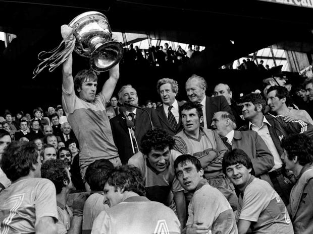 Alongside GAA president Paddy McFlynn and then Taoiseach Garrett FitzGerald, Kerry captain Jimmy Deenihan holds the Sam Maguire aloft after his team completed the All-Ireland four-in-a-row in 1981. Photo: Ray McManus / Sportsfile