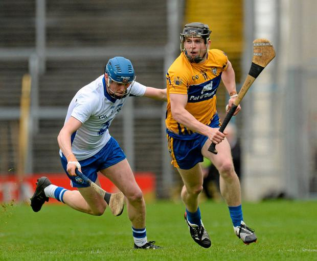 Tony Kelly of Clare escaping the attentions of Waterford's Austin in the 2016 NHL Division 1 final. Photo: Piaras Ó Mídheach / Sportsfile