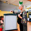 A woman casts her vote in the abortion referendum at Scoil Thomas Lodge polling station in Dublin yesterday. Photo: Jeff J Mitchell