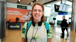 Shona Leahy arrives at Dublin Airport from London, having travelled to vote in the referendum. Photo: Clodagh Kilcoyne