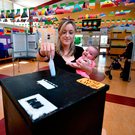 Niamh Gavin casts her vote in Athlone as she holds her daughter Fiadh (five months). Picture: Getty