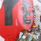 A woman left flowers at a mural to Savita Halappanavar, on South Richmond Street in Dublin, she was a 31-year-old Indian dentist who died in 2012 at University Hospital Galway in Ireland due to complications arising from a septic miscarriage. Picture credit; Damien Eagers 26/5/2018