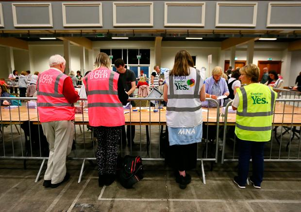 Tally volunteers watch the referendum ballot papers being counted at the Dublin County Count Centre in Citywest.Picture Credit:Frank Mc Grath