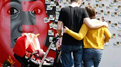 A couple and their child look at a mural to Savita Halappanavar, on South Richmond Street in Dublin, she was a 31-year-old Indian dentist who died in 2012 at University Hospital Galway in Ireland due to complications arising from a septic miscarriage. Picture credit; Damien Eagers 26/5/2018