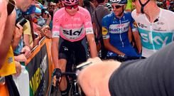 Britain's Chris Froome, in the pink jersey of the overall leader, makes his way to the start of the 20th stage of the Giro d'Italia