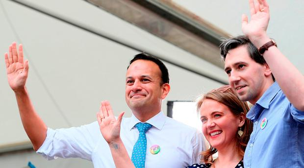 An Taoiseach Leo Varadkar (left), Minister for Health Simon Harris and Senator Catherine Noone wave to the crowd at Dublin Castle. Photo: Brian Lawless/PA Wire
