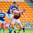 Ger Egan of Westmeath in action against Kieran Lillis of Laois