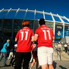 Liverpool fans wearing Mohamed Salah shirts walk towards the ground prior to the UEFA Champions League Final between Real Madrid and Liverpool at NSC Olimpiyskiy Stadium