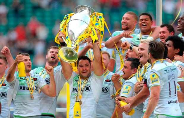 Saracens' Brad Barritt lifts the trophy after his side win the Premiership last year