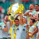 Saracens' Brad Barritt lifts the trophy after his side win the Aviva Premiership