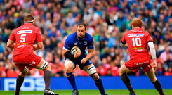 Rhys Ruddock of Leinster in action against Steve Cummins, left, and Rhys Patchell of Scarlets