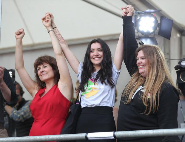 Campaigners Tara Flynn, Lucy Watmough and Roisin Ingle celebrate in Dublin Castle (Niall Carson/PA)