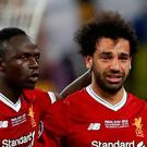 Liverpool's Sadio Mane consoles teammate Mohamed Salah as he is substituted off due to injury