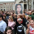 A supporter holds a photo of Savita Halappanavar (Niall Carson/PA)