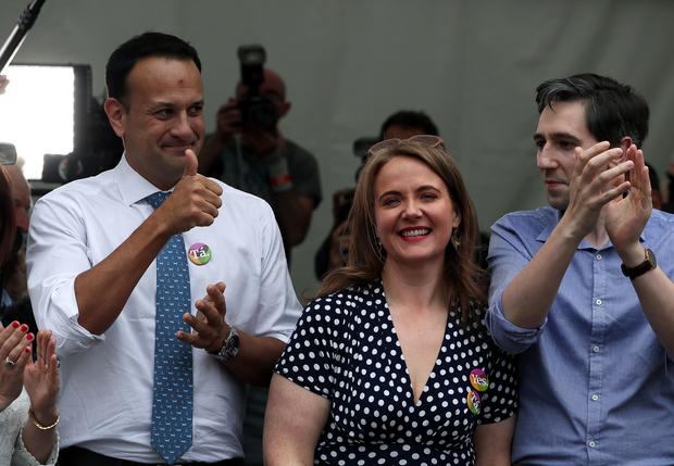 Leo Varadkar (left), Simon Harris (right) and Senator Catherine Noone celebrate at Dublin Castle (Brian Lawless/PA)