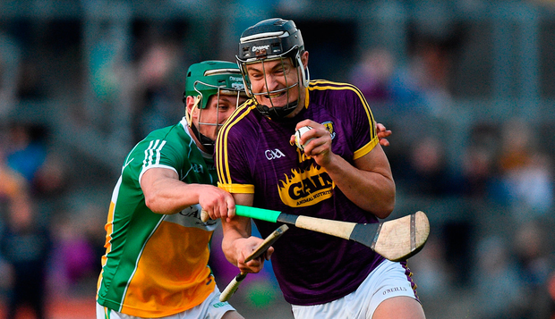 Jack O'Connor of Wexford in action against David King of Offaly