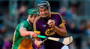 Jack O'Connor of Wexford tries to break through the tackle of Offaly's David King during the Leinster SHC clash at Bord na Mona O'Connor Park. Photo: Matt Browne/Sportsfile