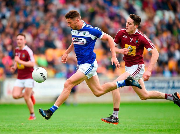 Colm Begley of Laois in action against Sam Duncan of Westmeath. Photo: Matt Browne/Sportsfile