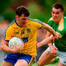 Diarmuid Murtagh of Roscommon in action against Paddy Maguire of Leitrim. Photo: Piaras Ó Mídheach/Sportsfile