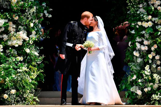 Meghan Markle and Prince Harry. Both dresses were designed by Givenchy.