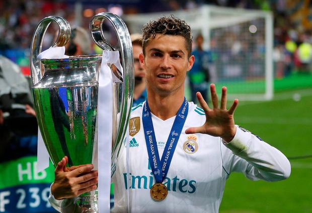 Real Madrid's Cristiano Ronaldo gestures as he celebrates winning the Champions League with the trophy