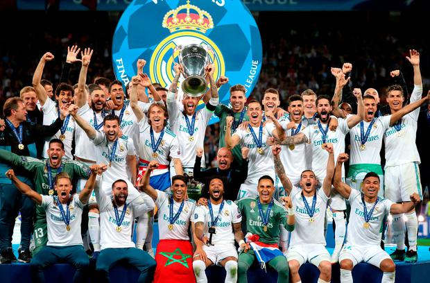 Real Madrid celebrate with the trophy. Photo: Nick Potts/PA Wire