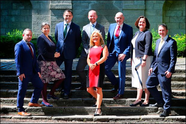 BIG LOSERS: From left in the back row are Jerry Buttimer, Marcella Corcoran Kennedy, Neale Richmond, Noel Rock, Ray Butler, Gabrielle McFadden and Joe Carey. At the front is FG local area rep, Ann Grainger
