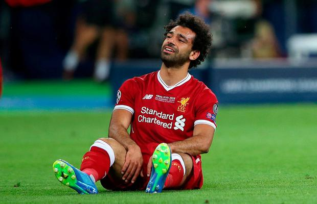 Liverpool's Mohamed Salah looks dejected after his injury in the Champions League final. Photo: Hannah McKay/Reuters