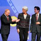 GLOBAL FORCES: From left, Russian President Vladimir Putin, International Monetary Fund Managing Director Christine Lagarde, Japanese Prime Minister Shinzo Abe and French President Emmanuel Macron at the St Petersburg International Economic Forum in Russia last week.