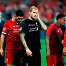 Liverpool players after the match. Photo: Mike Egerton/PA Wire