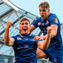 Jordan Larmour celebrates with Garry Ringrose after scoring Leinster's fourth try. Photo: Ramsey Cardy/Sportsfile