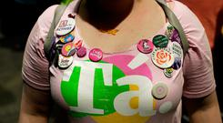 An activists shows off her campaign badges and T-shirt at the count centre as votes are tallied following Friday's referendum on liberalising abortion law, in Dublin, Ireland, May 26, 2018. REUTERS/Max Rossi