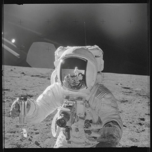 Astronaut Alan L. Bean holds a Special Environmental Sample Container filled with lunar soil collected during the Apollo 12 mission in this NASA handout photo provided November 19, 1969. NASA/Handout/File Photo via Reuters