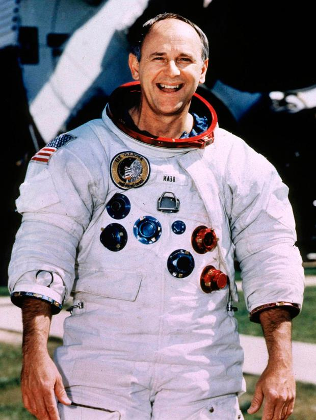 Retired Astronaut Alan Bean, 66, poses for a portrait in his spacesuit at the Johnson Space Center in Houston, Texas, U.S., in this undated photo. Bean, who was the fourth man to walk on the moon in 1969, left NASA in 1981 and made a successful transition from spaceman to a full-time professional artist. REUTERS/Stringer/File Photo