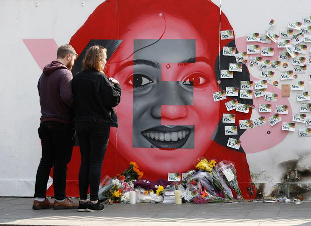 A couple look at a mural to Savita Halappanavar, on South Richmond Street in Dublin, she was a 31-year-old Indian dentist who died in 2012 at University Hospital Galway in Ireland due to complications arising from a septic miscarriage. Picture credit; Damien Eagers 26/5/2018