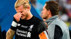 Liverpool's Loris Karius reacts on the pitch after the UEFA Champions League final