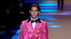 Paris Brosnan, the son of British actor Pierce Brosnan, presents a creation for fashion house Dolce & Gabbana during the Men's Fall/Winter 2019 fashion shows in Milan, on January 13, 2018. / AFP PHOTO / Marco BERTORELLO (Photo credit should read MARCO BERTORELLO/AFP/Getty Images)