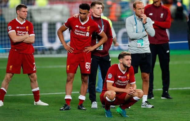 Liverpool's James Milner, Trent Alexander-Arnold and Adam Lallana look dejected after the match