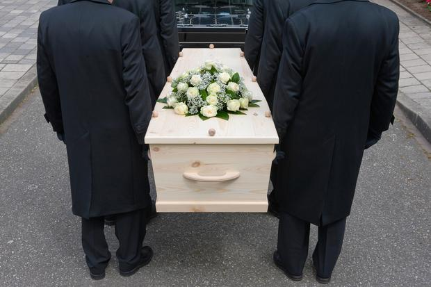 Bearers carrying a coffin. Stock image