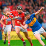 Dan McCormack of Tipperary in action against Mark Ellis of Cork
