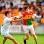 Ciaran Moran of Carlow in action against Eanna O'Connor of Kildare