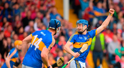Patrick Maher of Tipperary celebrates after his team mate Jake Morris scored a late point