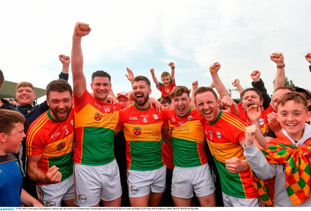 Carlow players and supporters celebrate