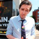 Health Minister Simon Harris speaking to the media at a Together for Yes billboard launch in Dublin, ahead of the referendum. Photo: Niall Carson/PA Wire