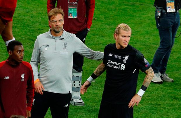 Liverpool's Loris Karius is dejected with manager Jurgen Klopp