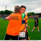 Clare joint manager Donal Moloney is congratulated by the the Clare full back Conor Cleary