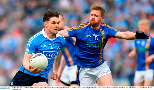 Eric Lowndes of Dublin is tackled by Kevin Murphy of Wicklow